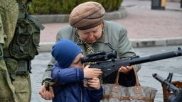 PHOTOGALLERY: Crimean Kids With Kalashnikovs: Critics Warn Of Growing Emphasis On 'Patriotic' Education