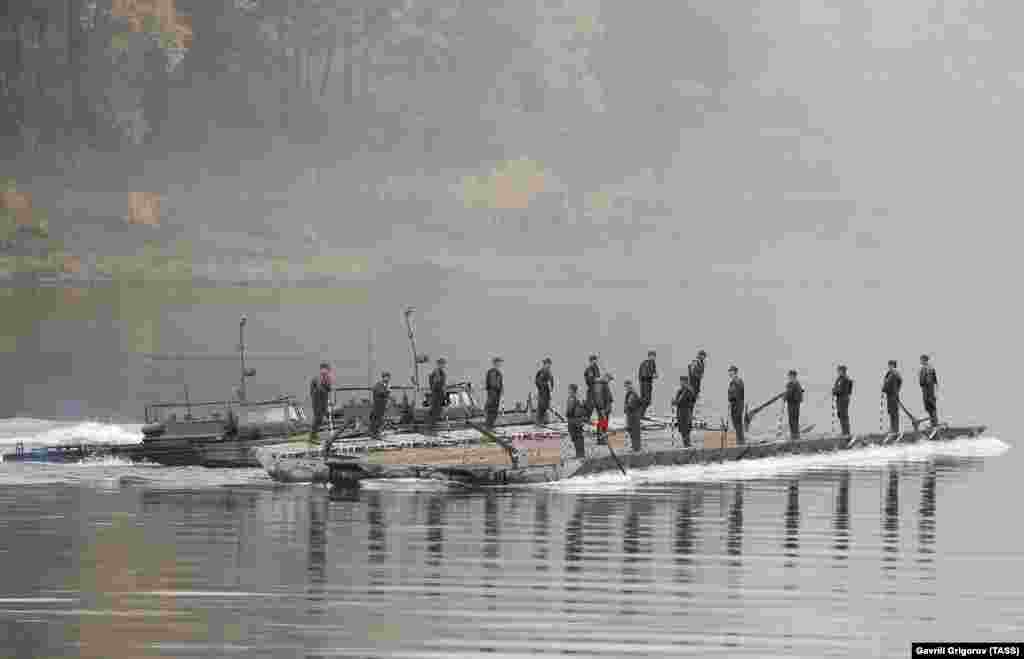 Russian troops on a section of a pontoon bridge being chugged across central Russia's Tom River. The Kremlin claims 128,000 troops are involved in the exercises, though foreign observers have suggested that number may be inflated to exaggerate the strength of Russia's military.