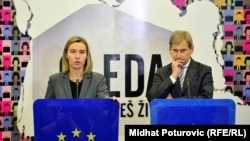 EU foreign-policy chief Federica Mogherini (left) and Enlargement Negotiations Commissioner Johannes Hahn in Sarajevo on December 5