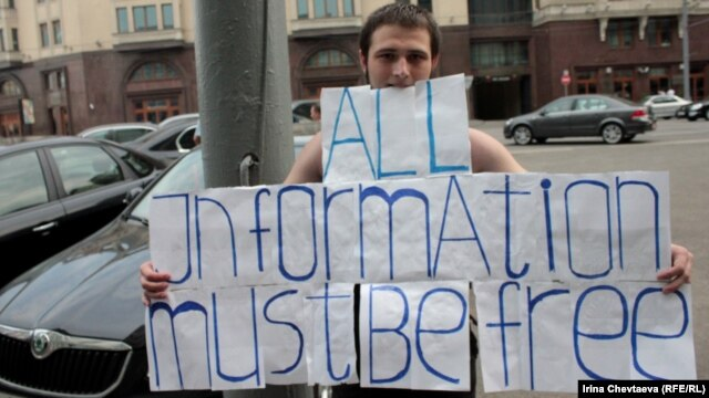 A protester demonstrates against censorship of the Internet near the State Duma in Moscow.