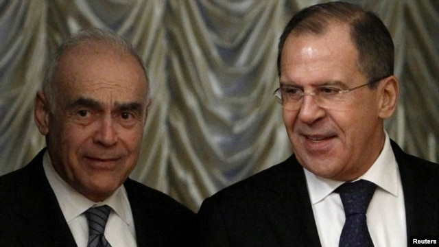 Egyptian Foreign Minister Muhammad Amr (left) and Russian Foreign Minister Sergei Lavrov arrive for a bilateral meeting in Moscow on December 28.
