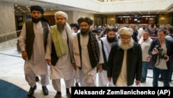 FILE: Mullah Abdul Ghani Baradar, the Taliban group's top political leader, third from left, arrived with other members of the Taliban delegation for talks in Moscow in May 28.