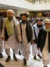 Mullah Abdul Ghani Baradar (third from left), the Taliban's top political leader, arrives with other members of a Taliban delegation for talks in Moscow on May 28, 2019.
