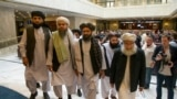FILE: Mullah Abdul Ghani Baradar, the Taliban group's top political leader, third from left, arrives with other members of the Taliban delegation for talks in Moscow in May 2019.