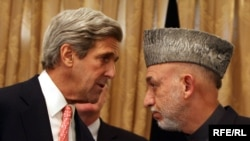 U.S. Senator John Kerry (Democrat, Massachusetts) talks with Afghan President Hamid Karzai in Kabul last year.