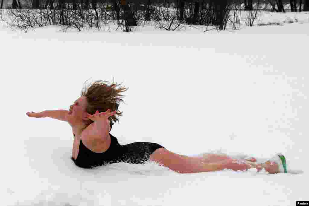 Galina Tiptsova, a model of the SibPlus Models agency and a participant of the Miss Doughnut beauty competition, jumps into the snow at the Polar Bear winter swimmers club in Krasnoyarsk, Siberia. (Reuters/Ilya Naymushin )