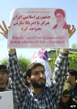 Iranian protestors, mainly members of the Basij Islamic militia, holds up a sign during a protest against the war in Iraq 12 April 2003, for the sixth consecutive day outside the British embassy in Tehran. AFP PHOTO/HENGHEMEH FAHIMI