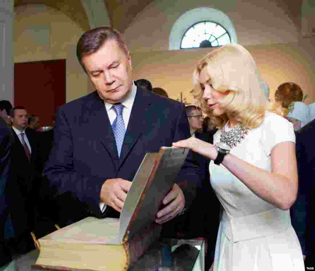 Ukrainian President Viktor Yanukovych takes part in the opening of an exhibition marking the 1,025th anniversary of the baptism of Kievan Rus on July 26.