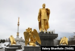 "When tourists in Ashgabat visit the sites, such as this monument to the late Turkmen President Saparmurat Niyazov, they must be accompanied by an official tour guide ""at all times."""