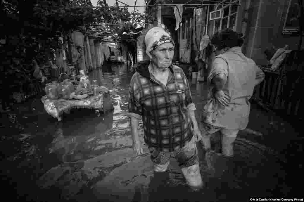 Photographer Alexander Zemlianichenko Jr. of Russia took this shot of a woman crying as she walks in front of her flooded house in Krymsk, Russia.