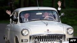 U.S. President George W. Bush drives Vladimir Putin's 1956 Volga, outside Moscow, in May 2005.