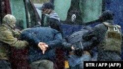 Law enforcement officers detain opposition supporters in Minsk on November 29.