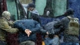 Law enforcement officers detain opposition supporters in Minsk, on November 29, 2020.