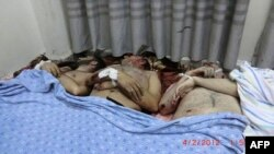 A picture posted on February 4 by the Syrian opposition allegedly shows victims killed in the shelling of a residential district of Homs on February 3.