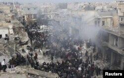 Сириядағы үкімет әскері мен көтерілісшілер арасындағы қақтығыстың бірінде Алеппо қаласына түскен зымыранның орны. 13 қаңтар 2013 жыл.