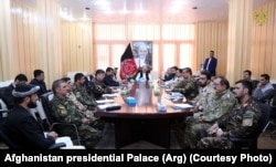 Ghani (center, back) meets with Afghan military commanders in Ghazni on August 17.