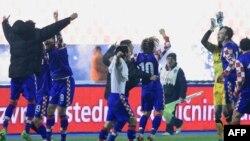 Cборная Хорватии празднует победу над командой Турции