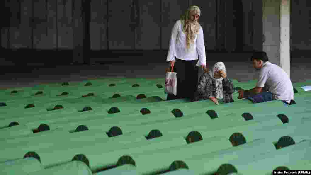 Mourners at one of the 520 coffins of newly identified victims of the 1995 Srebrenica massacre, which were laid out in Potocari on July 9.