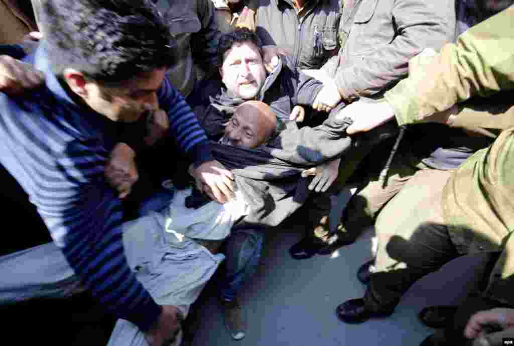 Indian policemen detain an Indian Kashmir lawmaker during a protest in Srinagar on March 7. (epa/Farooq Khan)