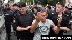It's not Russian opposition leader Aleksei Navalny's first run-in with the law. He has been sentenced to jail about a dozen times in recent years and has spent hundreds of days in custody. (file photo)