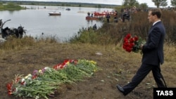 Then-President Dmitry Medvedev laying flowers at the site where the Yak-42 passenger plane crashed near Yaroslavl in September 2011, killing all the Lokomotiv team members aboard.