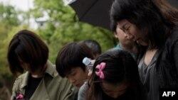 Во время похорон одного из погибших при крушении парома.