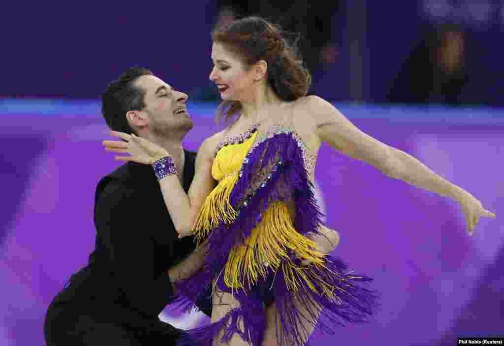Фигурное катание: Выступление фигуристов в парных танцах с Украиной Александры Назаровой и Максима Никитина во время короткой программы на зимней Олимпиаде 2018 года. Пхенчхан, Южная Корея, 19 февраля 2018 года