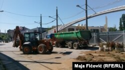 Construction work begins on the Ibar bridge that connects the Albanian and Serbian parts of Mitrovica on August 14.