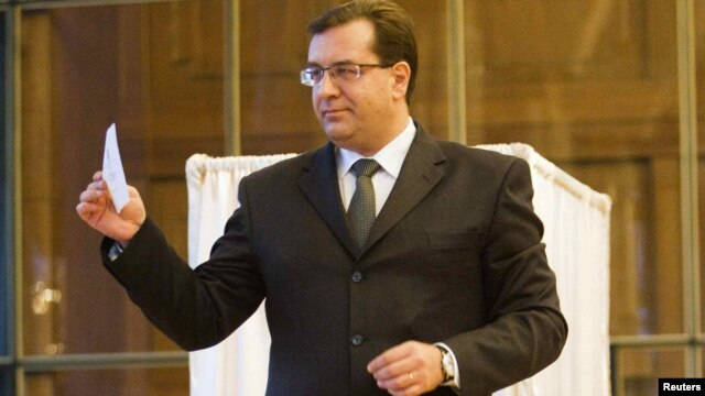 Acting President Marian Lupu casts his vote during a presidential election in parliament in Chisinau on December 16.