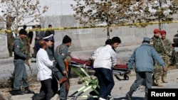 Afghanistan -- Officials carry a dead body on a stretcher at the site of a blast in Kabul, November 16, 2014