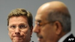 """IAEA Director-General Muhammad el-Baradei (right) told reporters at a joint press conference with German Foreign Minister Guido Westerwelle on November 25 that a nuclear-fuel swap within Iran is """"not an option."""""""