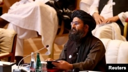 Mullah Abdul Ghani Baradar, who led the Taliban delegation in Doha, speaks at the commencement of peace talks with the Afghan government in Doha on September 12.