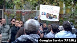 Journalists film a protest in Tbilisi in October that targeted former President Mikheil Saakashvili.