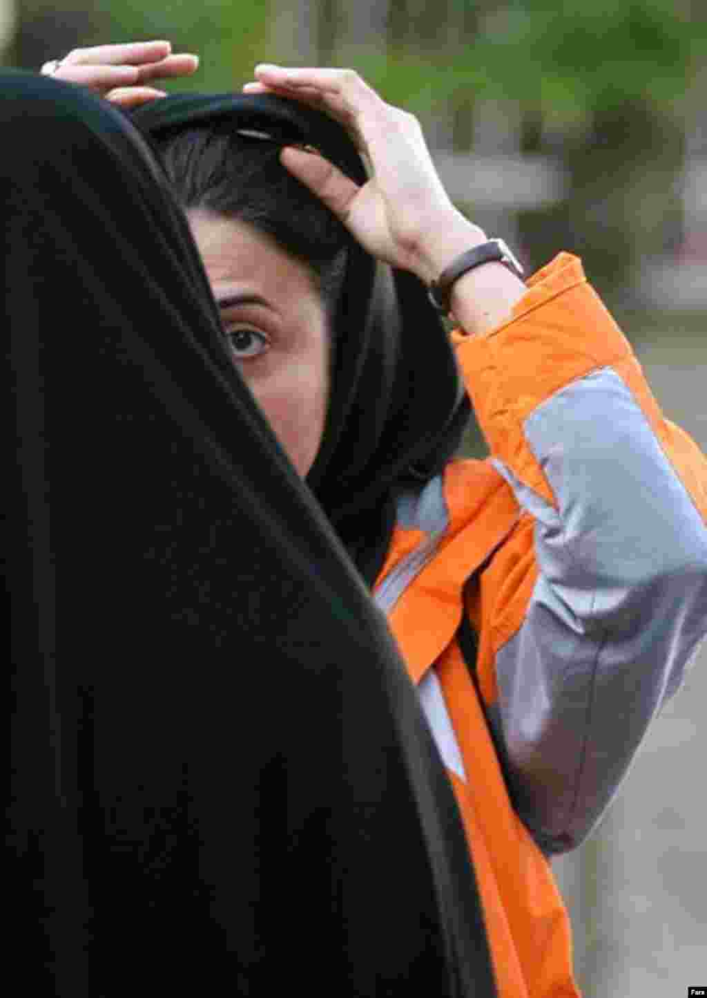 "Police and Basij activists check women for proper dress in Tehran on April 22 (Fars) - This year's crackdown has drawn mixed reactions among officials, the public, and the press. The head of Iran's judiciary, Ayatollah Mahmud Hashemi-Sharudi, has warned against heavy-handed actions against women. He was quoted by Iranian newspapers as saying that ""tough measures on social problems will backfire and have counterproductive effects."""