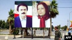 پوستر مریم و مسعود رجوی، دو تن از متهمان به جنایت علیه بشریت در عراق، در اردوگاه اشرف عراق