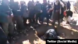 A grab from the video footage showing the stoning, which is alleged to have taken place in Afghanistan.