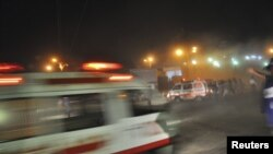 Rescue workers and ambulances are seen at the site of a second bomb blast in Karachi overnight on November 21-22.