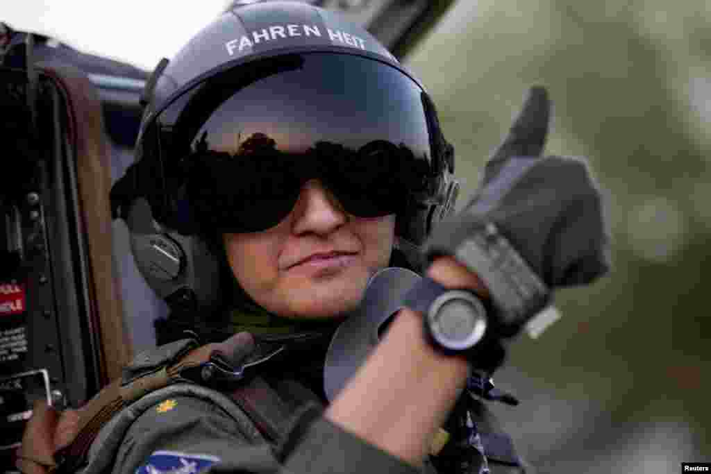 Ayesha Farooq gives the thumb-up sign from the cockpit of a Chinese-made F-7PG fighter jet at Mushaf base in Sargodha