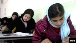 Many Afghan girls have returned to school since the fall of the Taliban -- but old attitudes persist about women's roles.