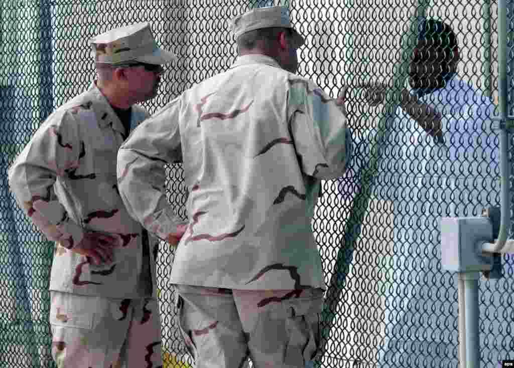 U.S. guards talk to a prisoner at Guantanamo Bay.
