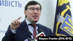 Ukrainian Prosecutor-General Yuriy Lutsenko speaks at a press conference in Kyiv on March 7.