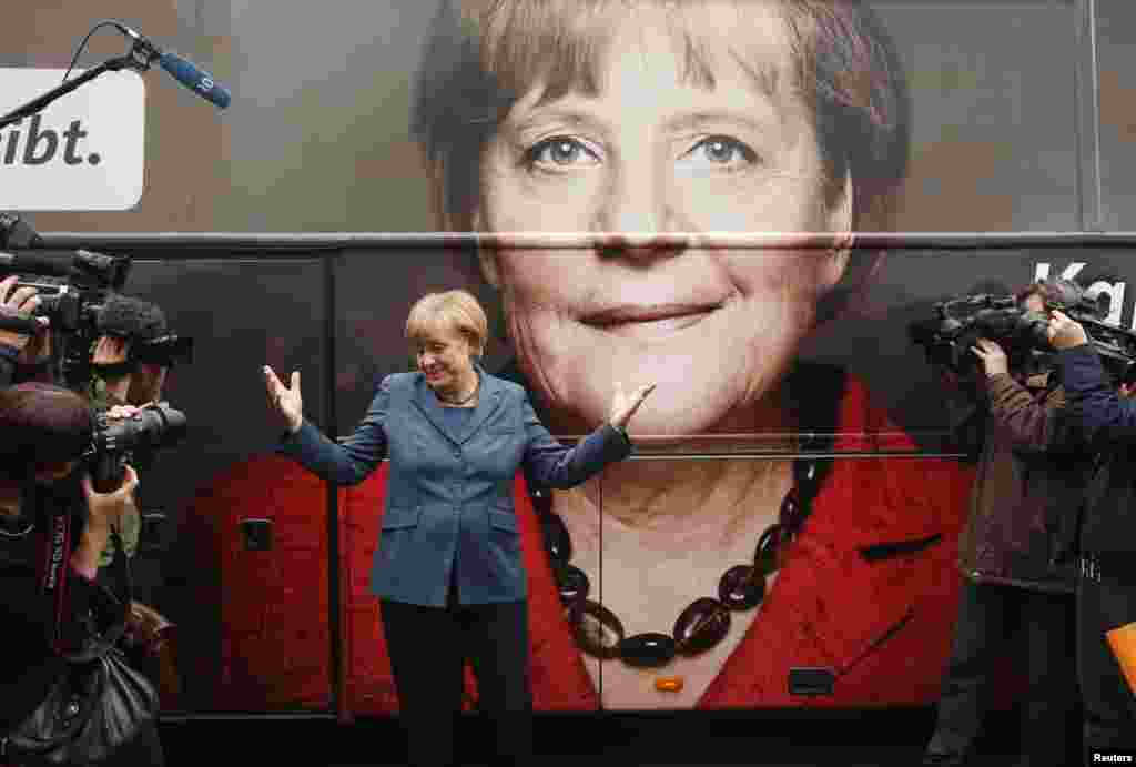 Merkel stands in front of her election campaign tour bus before a CDU board meeting in Berlin in September 2013.