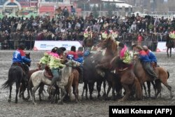 Horsemen compete during Afghanistan's first Buzkashi League, in Kabul in March.