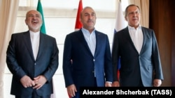 (From left to right) Iranian Foreign Minister Mohammad Javad Zarif, Turkish Foreign Minister Mevlut Cavusoglu, and Russian Foreign Minister Sergei Lavrov in Antalya on November 19.