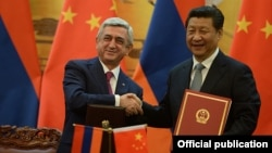 China - President Xi Jinping and his visiting Armenian counterpart Serzh Sarkisian adopt a joint declaration after talks in Beijing, 25Mar2015.