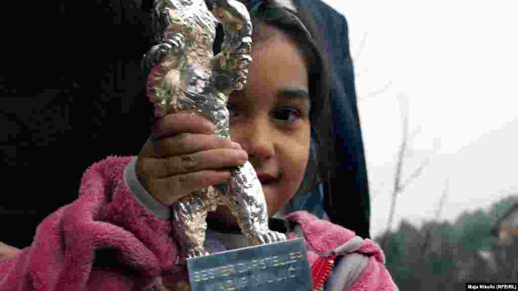 The couple's daughter shows off the Silver Bear award.