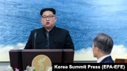 SOUTH KOREA -- North Korean leader Kim Jong-Un speaks during a reception dinner at the Peace House on Joint Security Area (JSA) on the Demilitarized Zone (DMZ) in the border village of Panmunjom in Paju, April 27, 2018