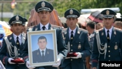 Armenia - The funeral in Yerevan of Yuri Tepanosian, an Armenian police officer killed in a standoff between security forces and opposition gunmen, 1Aug2016.