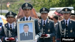 Armenia - The funeral in Yerevan of Yuri Tepanosian, an Armenian police officer killed during a standoff between security forces and opposition gunmen, 1Aug2016.