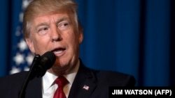 U.S. President Donald Trump delivers a statement late on July 6 in Florida announcing missile strikes against Syria in retaliation for a suspected chemical-weapons attack by regime forces.